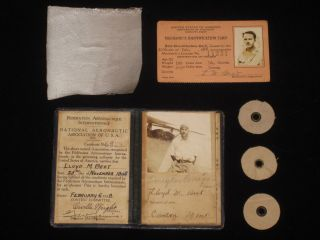 "Pilot License, Aviator's Certificate, Signed By Orville Wright and Douglas ""Wrong Way"" Corrigan Together with 3 Cowling Rings and a Piece of Fabric from the Spirit of St. Louis with Photos and Documents Related to Early Aviation. Orville Wright, Douglas ""Wrong Way"" Corrigan, Charles Lindbergh, Lloyd M. Best, T. Claude Ryan, John Van Der Linde, J. J. ""Red"" Harrigan, B. F. Mahoney, Hawley Bowlus, Donald A. Hall."