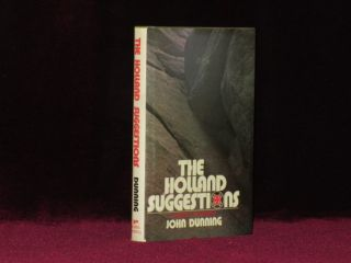 THE HOLLAND SUGGESTIONS. A Novel of Suspense. John DUNNING, SIGNED