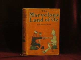 THE MARVELOUS LAND OF OZ. Being an Account of the Further Adventures of the Scarecrow and Tin Woodman...A Sequel to The Wizard of OZ. L. Frank Baum, John R. Neill.