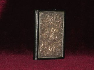Address Book, with Four Angels in Silver Bas-Relief on Front Panel. N/A